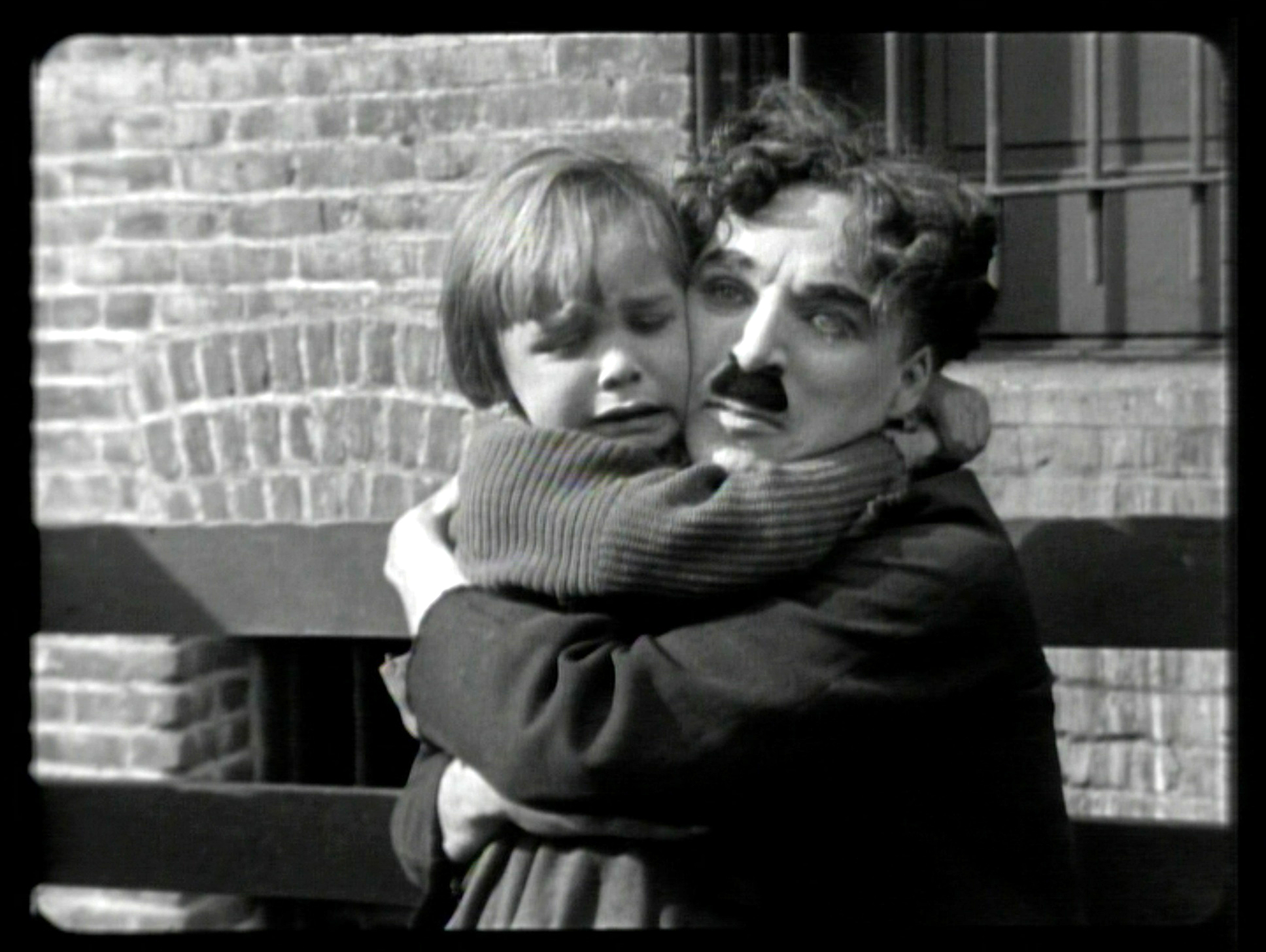 a review of the kid by charlie chaplin Parents need to know that the kid is charlie chaplin's first feature-length release, a silent picture from 1921 the film chronicles another episode in the life of his famous character, the tramp, who this time finds an abandoned baby and decides to raise it as his own.