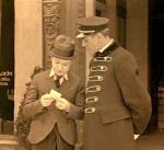 Harry shows the doorman a tiny photo of Mary