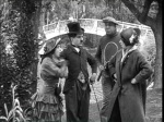 Mabel Normand, Chaplin, Mack Swain, and Eva Nelson in Mabel's Married Life (1914) beside the Echo Park bridge.
