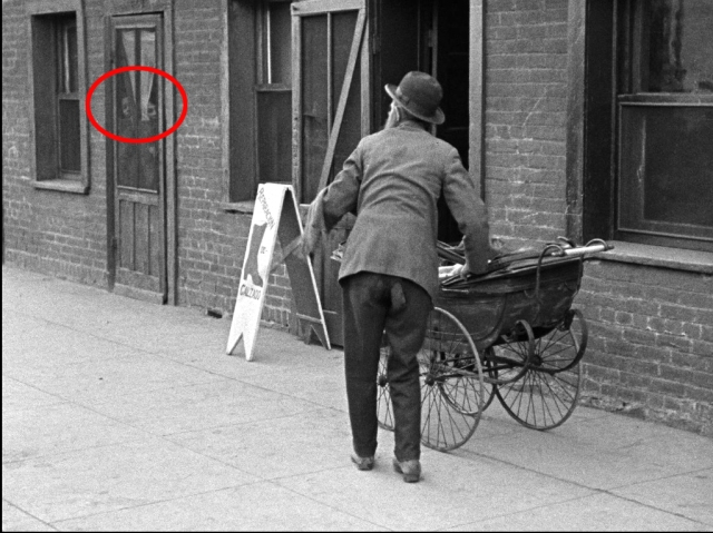 Two girls are seen here as Dan Dillon returns the foundling baby to Minnie Stearns' stroller.