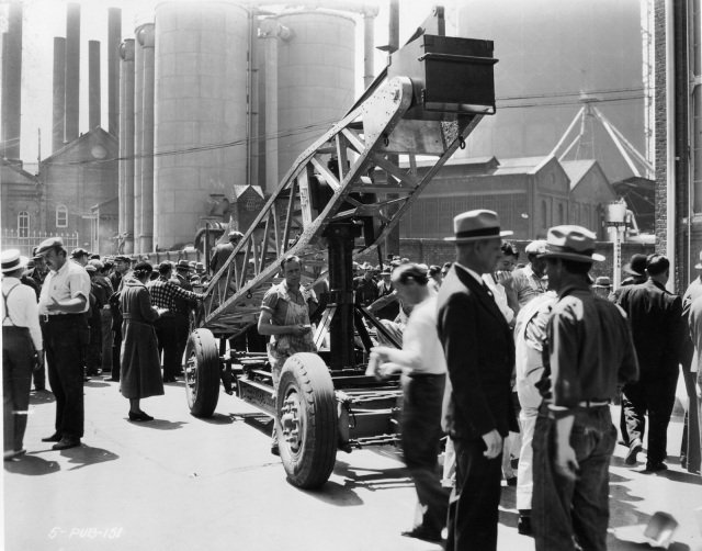 The Chaplin crew at work filming Modern Times near the corner of Ramirez and Howard (note the street sign at back).
